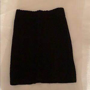 Tight fitting black skirt
